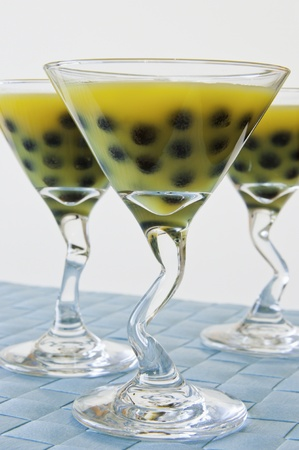 Three martini glasses of mango bubble tea with black bubbles Stock Photo