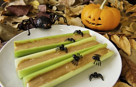 Celery sticks with peanut butter and Halloween spiders