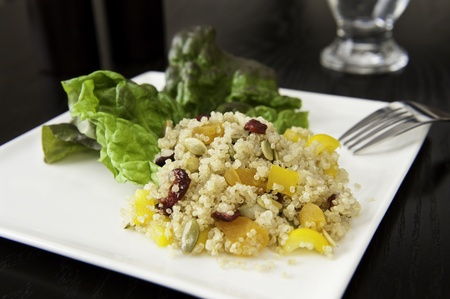 Quinoa salad with cranberries, apricots, peppers and pumpkin seeds