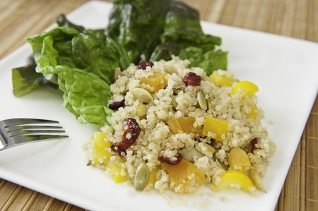Quinoa salad with dried fruit and colored peppers