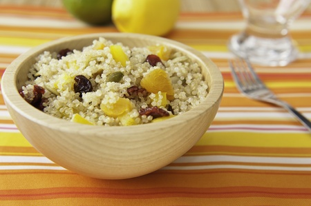 Colorful fruit and quinoa salad with pumpkin seeds