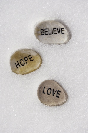 hope: Believe, hope and love rock in fresh snow Stock Photo
