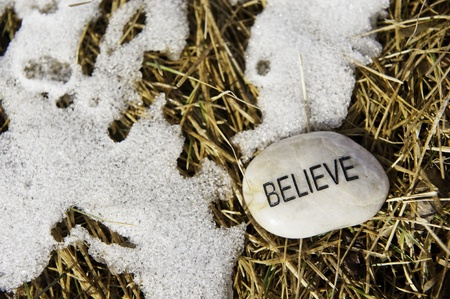 Believe rock with melting snow