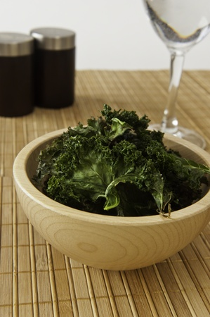 Healthy snack of a bowl of roasted kale chips