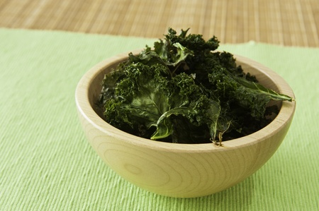 Wooden bowl of roasted kale chips