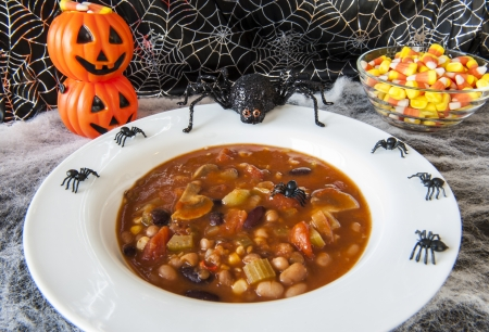 Hungry Halloween spiders enjoying a bowl of vegetarian chili photo