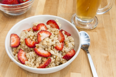 Warm breakfast of millet with walnuts and strawberries