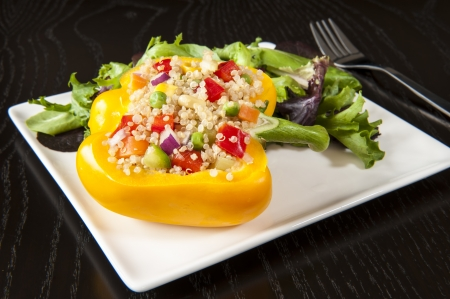 Quinoa stuffed yellow pepper with mixed green salad