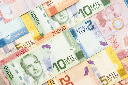 rican: Colorful assortment of various denominations of Costa Rican Colones bills Stock Photo
