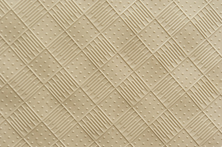 rubber mat texture of raised squares with alternating lines and dots Stock Photo
