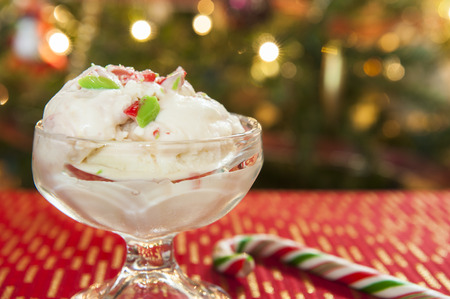 Dish of candy cane ice cream in front of the Christmas tree