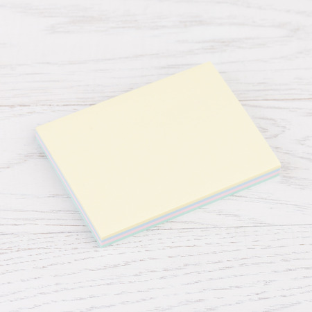 Pack of sticky stickers note on wooden white background photo