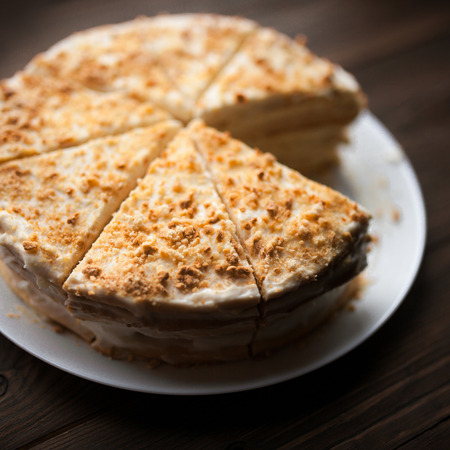 carrot cakes: Homemade honey cake with cut piece on a wooden table