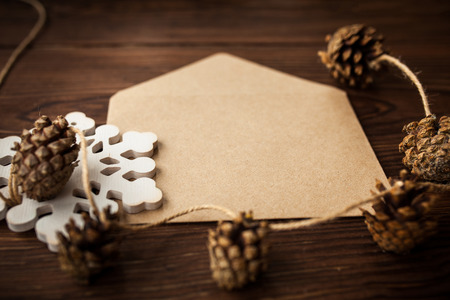 Envelope with Christmas decoration on brown wood table photo
