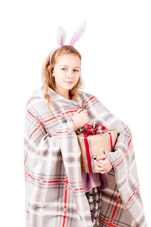jams: Girl holding gift box isolated on white Stock Photo