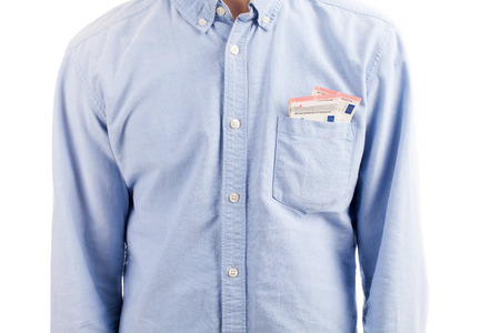 money pocket: una camisa de hombre con el dinero del bolsillo aislado en blanco