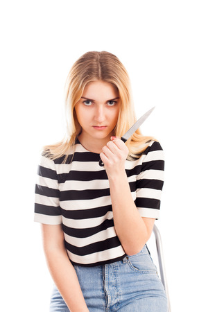 girl with knife: Angry girl with knife isolated on white Stock Photo