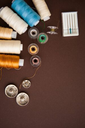 Sewing tools on the dark brown background with the copy space for your text Banque d'images