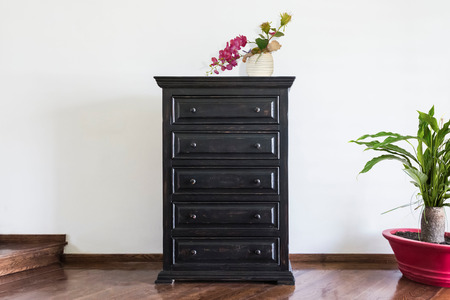 Wooden Stand with Drawers in Black Colour a Flower Pot on it