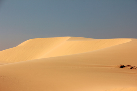 A beautiful picture of the sand dune (White  sand dune) with blue sky background in summer in Mui Ne, Vietnam.