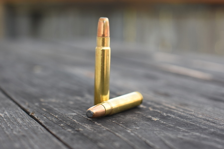 Two 416 Ammunition on the wooden background 版權商用圖片