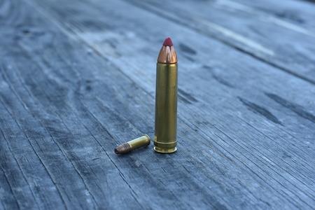 differnt: Red tip ammunition differnt size on wooden background Stock Photo