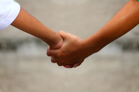 Two people are holding each other hands photo