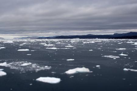 Greenland glaciers mountains ocean sky