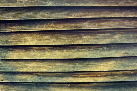 Aged old vintage dark blue yellow colors wooden wood background