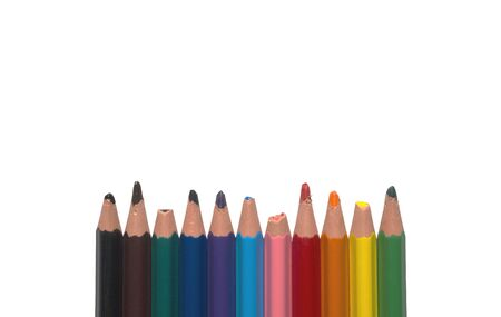 blunt pencils broken used colored not new children childrens in one row line isolated close up closeup