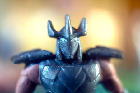 toy ancient warrior with armor armour and horns hornsby blur background bright