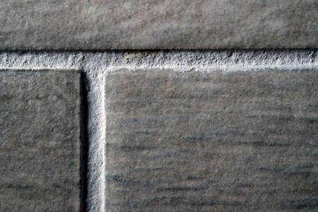 stone ceramic glued tiles seams close-up macro texture background