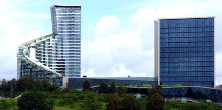 2 two modern buildings panorama glass Lithuania Konstitucijos prospectus street 15 20a Vilnius summer Stock Photo