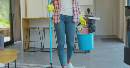 Happy cleaning service employee ready to start working, positive work attitude