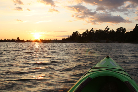 Sunset on Georgian Bay at Parry Sound view from kayak with ripples in the water