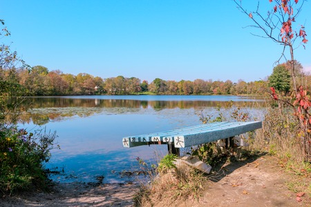 Bench Overlooking The Water on a canadian fall day Stock Photo