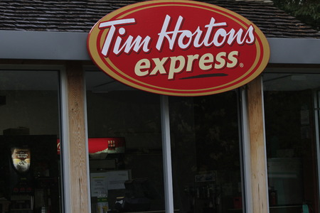 TORONTO, CANADA- October 29 2018: The outside of a Tim Hortons Coffee Shop during the day Editorial