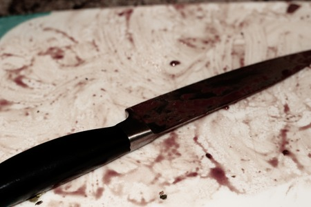 with knife over cutting board from cutting bloody organ Stok Fotoğraf