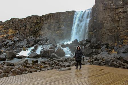 women at Thingvellir National Park or better known as Iceland pingvellir National Park during winter
