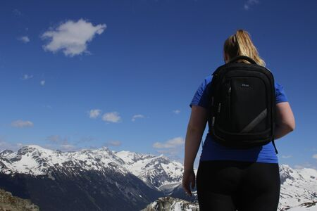 June 16 2018, Whistler Canada:a women at the peak of whistler mountain.