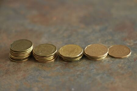 Canadian coins. Pile of Canadian dollar coins aka loonies Banco de Imagens