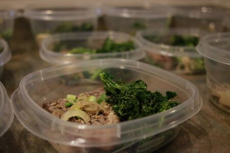 Healthy meal prep containers with quinoa, chicken and cole slaw. Standard-Bild - 134968040