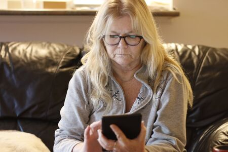 Senior woman using digital tablet at home