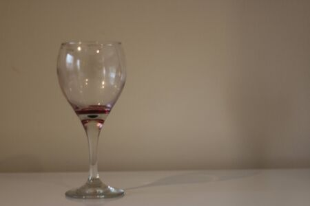 Alcoholwine empty glass on white stock.