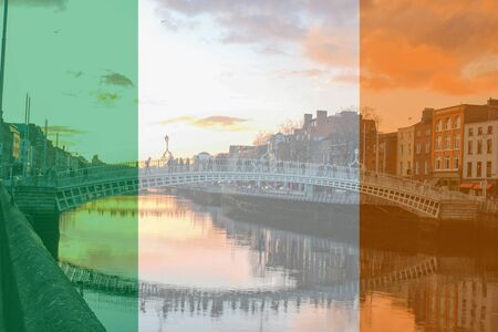 Theme of Irish heritage the Irish flag as a composite over Ha'Penny Bridge Stock Photo