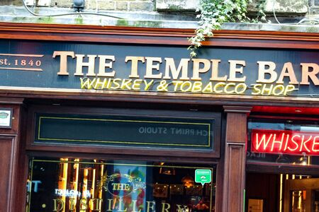 Dublin Ireland, February 18 2018: View of a famous pub, at the Temple Bar area in central Dublin. Temple Bar is promoted as Dublin's cultural quarter and is visited by hundred of tourists every day. Pub culture has evolved in Ireland and is a central part