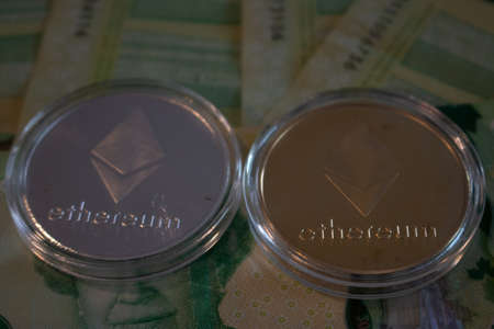 London Canada, January 24 2020: Editorial Illustrative photo of Etherum coins on Canadian currency. Etherum is a leading crypto currency.