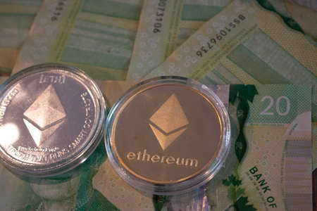 London Canada, January 24 2020: Editorial Illustrative photo of Gold etherum classic coin, on background of computer motherboard. 報道画像