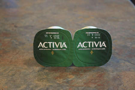 London Canada, June 09 2020: Editorial illustrative photo of activia yogurt containers. Theme of eating healthy