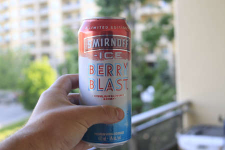 London Canada, June 09 2020: Editorial illustrative photo of Smirnoff ice berry blast alcoholic cooler. A common summer drink, theme of cooling off